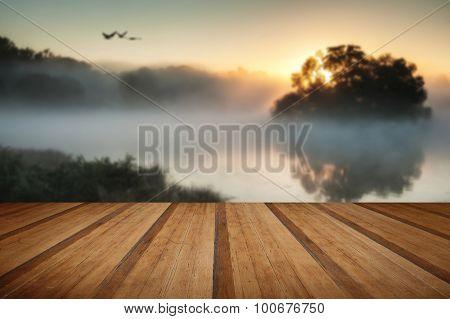 Beautiful Autumnal Landscape Image Of Birds Flying Over Misty Lake At Sunrise With Wooden Planks Flo