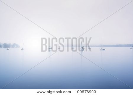 Sailing Boats Foggy Morning On Lake Windermere In Lake District In Blue Tone