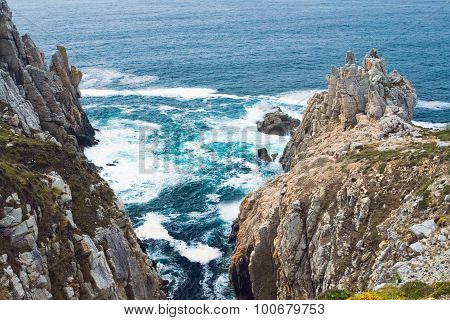 Rock Cliffs On The Background Of Emerald Sea. Bretagne, France.