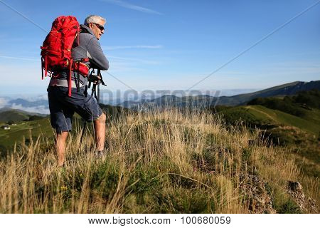 Hiker in Basque country mountains looking at scenery