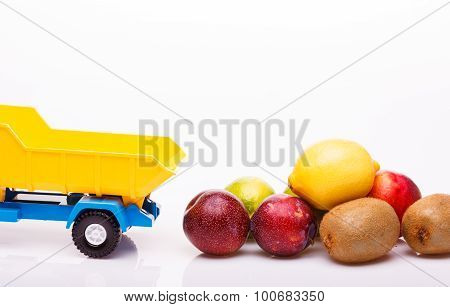 Tropical Fruits Near Toy Truck