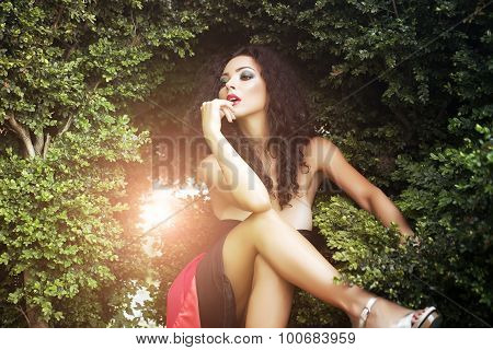 Glamour Sexy Woman Posing Near Bush