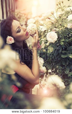 Tender Youn Woman Smelling Rose Flower