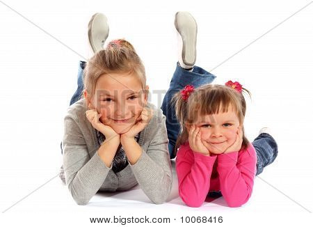 Two Young Sisters Posing Together In A Studio