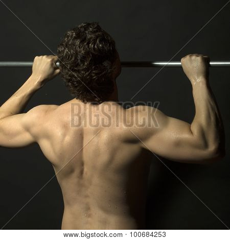 Brunette Man Doing Chin-ups