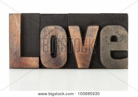 Love, word written with vintage letterpress printing blocks isolated on white background