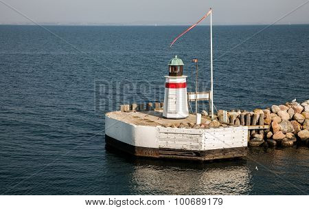 Lighthouse at the harbor entry Aero island Denmark