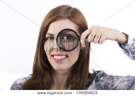 Female face looking through magnifier