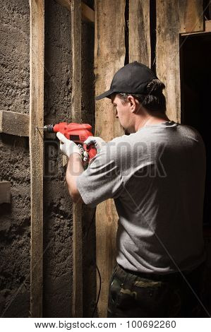 Builder Work An Electric Drill