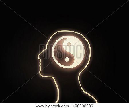 Human head with yin yang icon on dark background