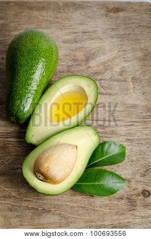 Fresh Avocado Isolated On Wooden Background