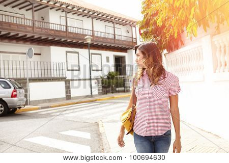 Young Woman Walking Outdoors And Looking Away