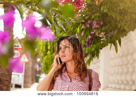 Caucasian Lady Talking On Cell Phone While Walking
