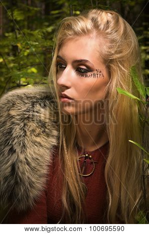 Scandinavian  Girl With Runic Signs In A Wood