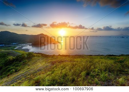 Village with beautiful sunset over hong kong coastline. View from the top of mountain