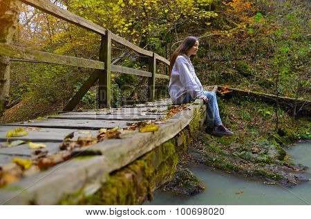 Girl On The Bridge. Forest. Autumn.