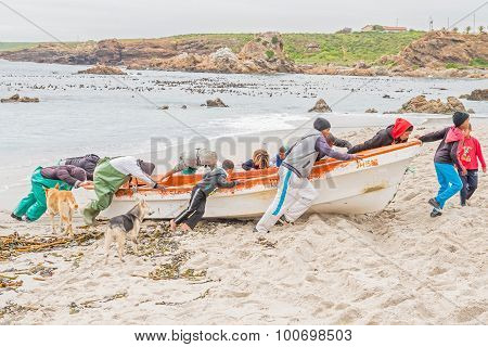 Fishermen Moves Their Boat To Above The High Water Mark