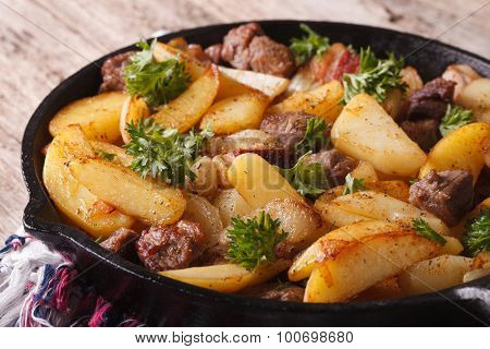 Fried Potatoes With Meat And Bacon In A Pan Close-up. Horizontal