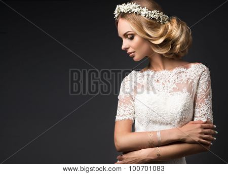 Portrait of a beautiful girl with flowers on her hair. Beauty face. Wedding image in the style boho
