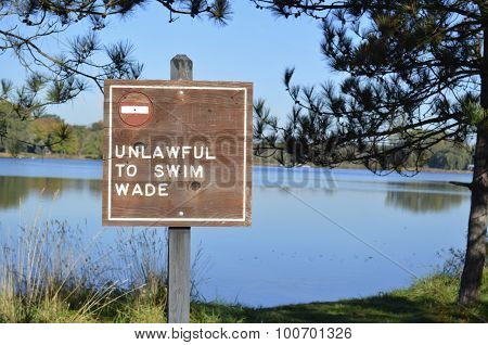 Unlawful to swim or wade sign