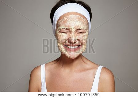 woman making facial treatment