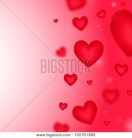 Pink  background with falling blurred hearts.