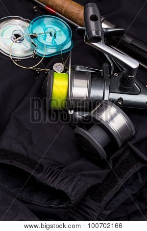 Fishing Tackles On Black Jacket
