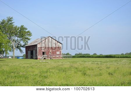 Weathered outbuilding and countryside
