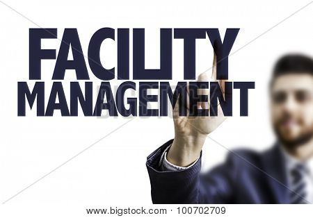 Business man pointing the text: Facility Management