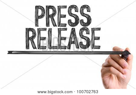 Hand with marker writing the word Press Release