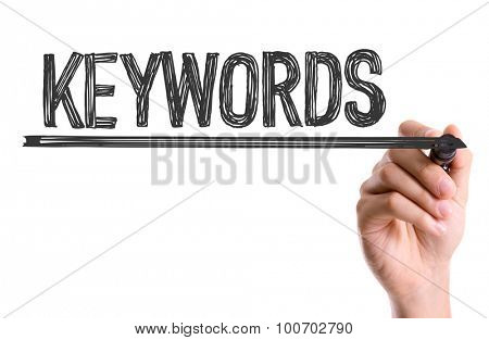 Hand with marker writing the word Keywords