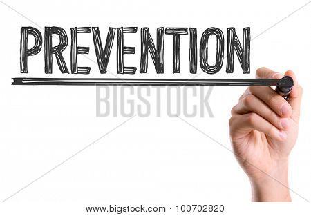 Hand with marker writing the word Prevention