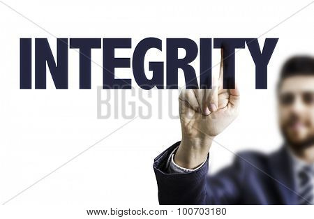 Business man pointing the text: Integrity