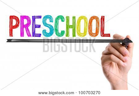 Hand with marker writing the word Preschool