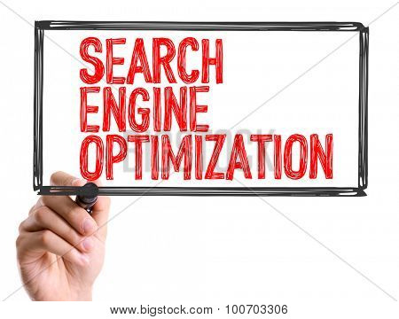 Hand with marker writing the word Search Engine Optimization