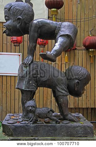 statue of two small chinese gymnasts