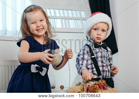 Little Boy And Girl In Christmas Decorations Expect A Miracle