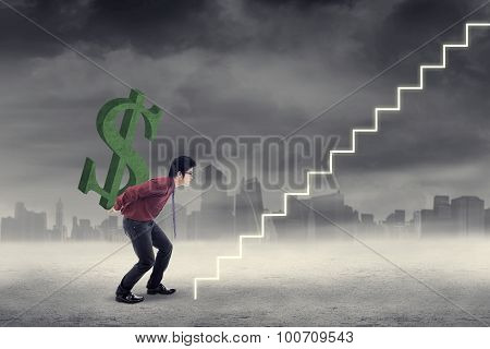 Young Asian Businessman Carrying A Dollar Sign