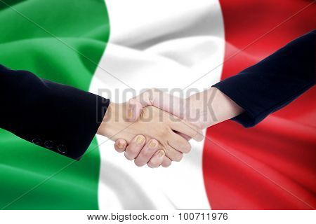 Handshake With An Italy Flag Background