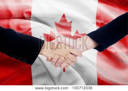 Handshake With Canada Flag Background