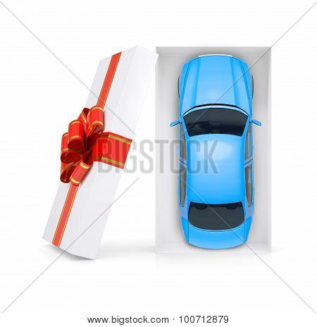 Blue car in gift box on white, top view