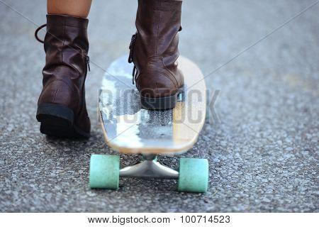 closeup feet on skate board