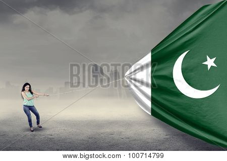 Pakistani Woman Pulling A Flag