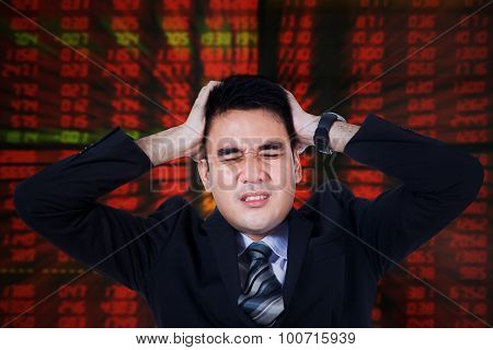 Stressful Stock Broker With Hands On Head