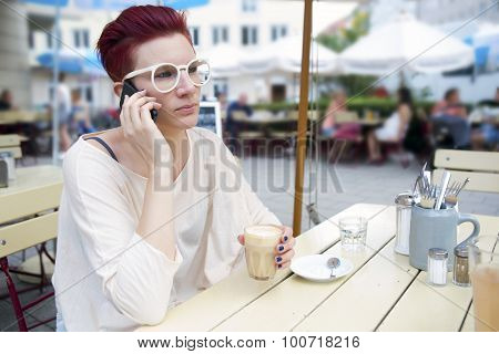 Red-haired Woman Outside Talking On The Phone