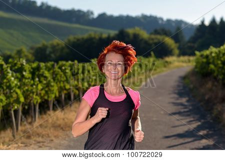 Pretty Vivacious Redhead Woman Out Jogging