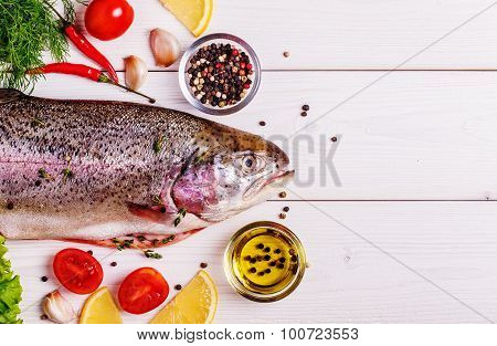Raw Trout With Spices On A Light  Background
