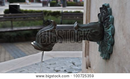 Metal drinking fountain in Hungary
