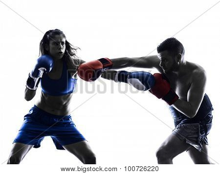 one woman boxer boxing one man  kickboxing in silhouette isolated on white background