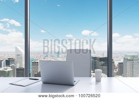 A Workplace In A Modern Panoramic Office With New York View. A White Table, White Leather Chair. Lap